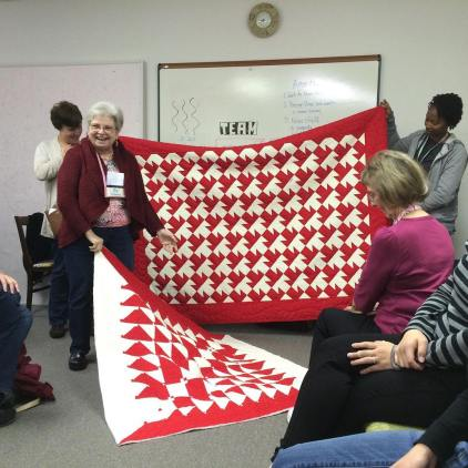 Joy talks about how she used her leftover scraps from one quilt to make the second. She also shows us her beautiful quilts with amazing quilting on each.