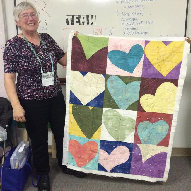 Hearts were a happy coincidence for February's meeting and we loved it! Linda shows off her lovely wonky heart quilt.