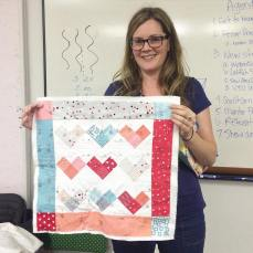 Amy keeps the heart theme going showing us the quilting she's doing on her mini quilt. All the love for hearts this month!