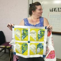 Julie shows us the two Half Hearted mini quilts.